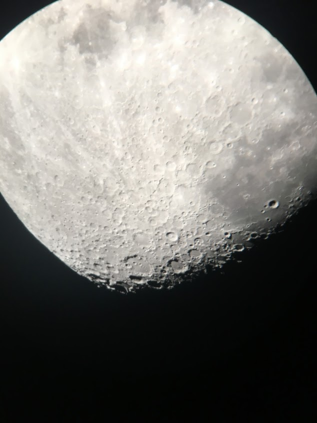Looking at the moon through the largest of the two telescopes